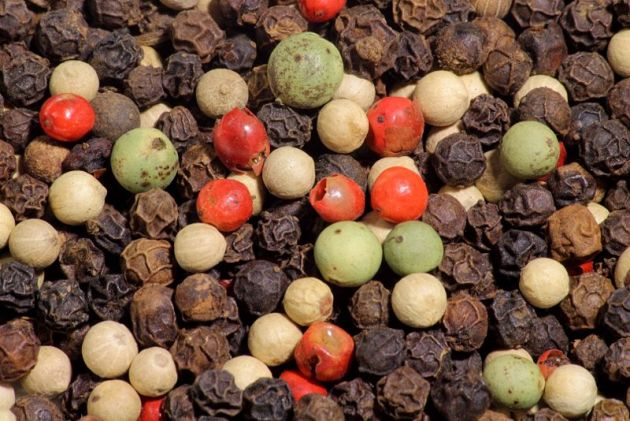 Black, green, pink and white peppercorns