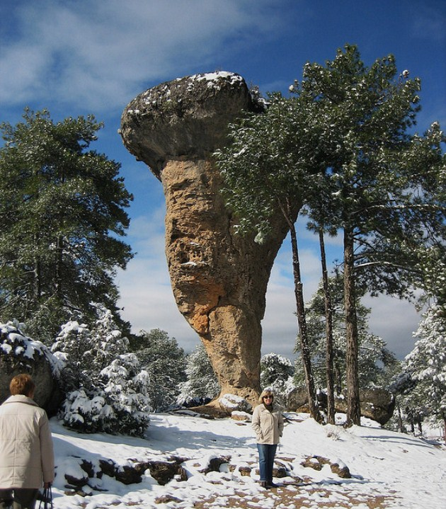 Snow-covered mushroom rock